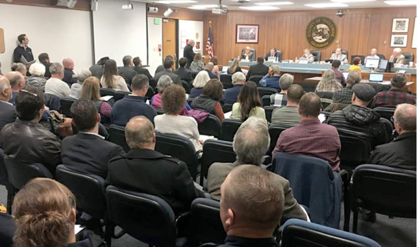 The public hearing in the Board of Supervisors office.